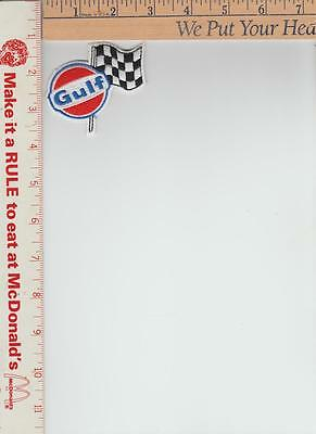 gulf oil patch with racing flag