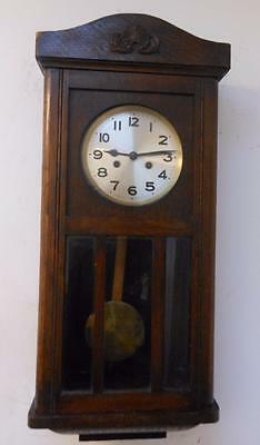 german oak cased striking wall clock c1930s