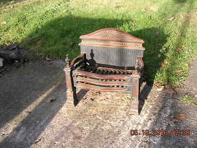 Vintage Cast Iron Dog Grate/Fire Basket with brass knobs.