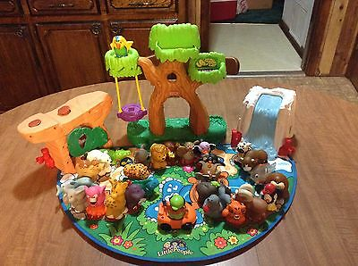 Fisher Price Little People A-Z Learning Zoo Playset 26 Animals, Ice Slide & Rock