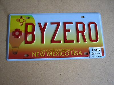 """Nm Vanity License Plate """" By Zero """" I'm Traveling Now And Will Be Back January 1"""