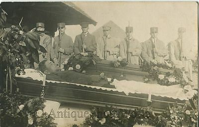 Young man soldier in casket post mortem military mourners rifles antique photo