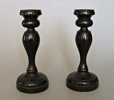 Pair of vintage ebony wood candlesticks with metal cups.