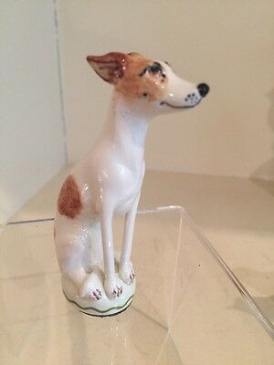 A Charming Porcelain Miranda Smith White Whippet  With Brown Spots Signed
