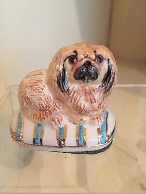 A Regal Porcelain Pekingese Facing Left On A Cushion  By Miranda Smith ,Signed