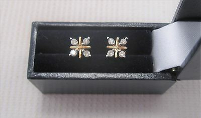 A Pretty Pair of Diamond Earrings set in 9ct Yellow Gold