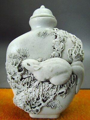 Chinese White Porcelain Carved Squirrel Pinaster Pattern Snuff Bottle