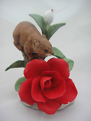 Cute Little Figure of a Mouse on a Rose