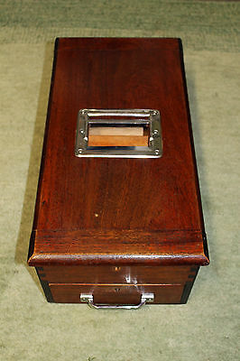 A lovely wooden vintage cash till with bell and keys