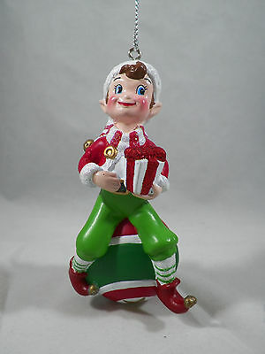 Elf Sitting on an Ornament Holding a Present Christmas Tree Ornament new holiday