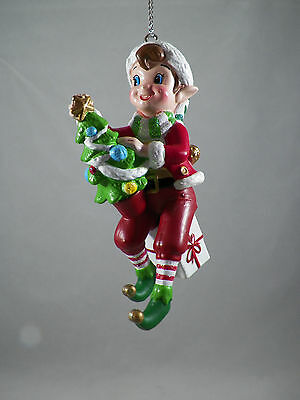 Elf Sitting on an Package Holding a Tree Christmas Tree Ornament new holiday