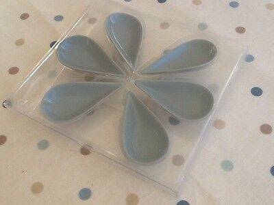 Box of sauce, pickle or chutney dishes shaped like raindrops. French grey colour