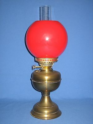 Brass dual wick oil lamp with vibrant red shade