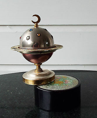 Windmill Zodiac Jewelled Lighter Inside a Globe Rotating on top of a Music Box