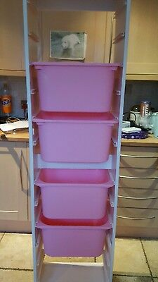 ikea large trofast storage unit with pink boxes