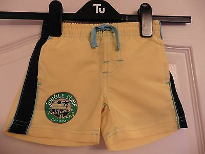 Boys yellow swim shorts with pockets for age 9-12 months