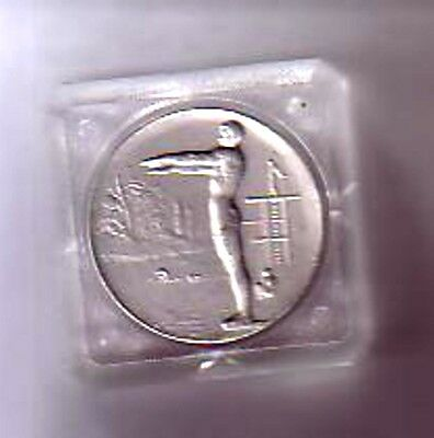 Silver coloured Diving Medallion in clear plastic capsule