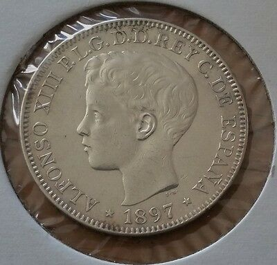 1897 Sgv Spanish Philippines . Peso . Silver Coin . Uncirculated .  Km# 154