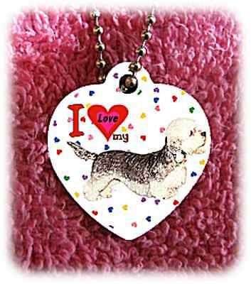 "Dandie Dinmont Dog heart necklace 24"" chain background of hearts"