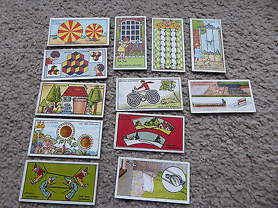 12 old Cigarettes Cards - 10 x Optical Illusions - 2 x Household Hints