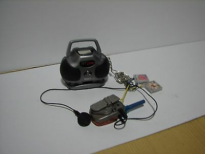 Tiger Hit Clips Mini Boombox Music Player and Radio With 2 Key Chain Clips