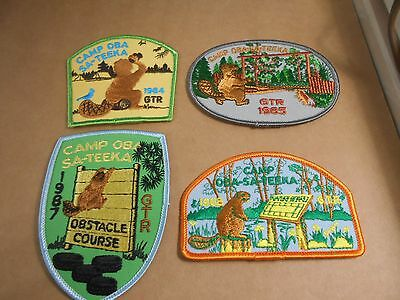 (Rz8-R)  Four  Oba-Sa-Teeka Scout Camp Badges   Canadian Scout Badges