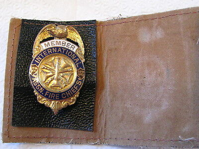 """Vintage Fire  Chief  Badge  with leather holder.  2"""" long.  1-1/4"""" across. Mint"""