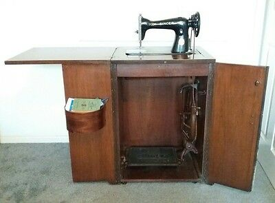 Fold-away working Singer treadle Sewing Machine in cabinet + accessories VGC