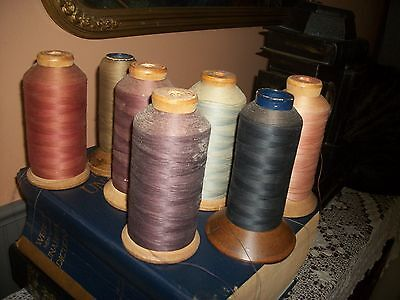 large antique wooden spools of thread-dffrnt. clrs.