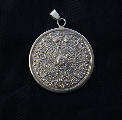 Rare vintage mexican aztec calendar pendant, silver plated, strike two side