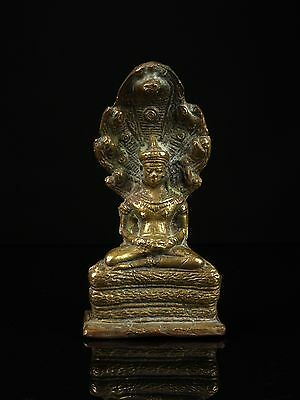 A Khmer Bronze Seated Figure of Buddha Muchalinda - Cambodia.