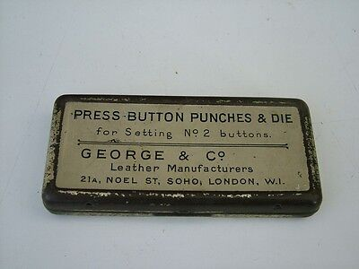 A VINTAGE GEORGE & Co BUTTON PUNCH TIN