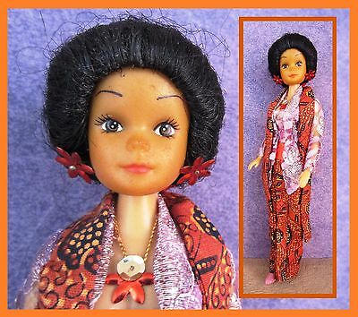 Vintage doll, Barbie clone doll in Asia outfit, suntanned, Simba?