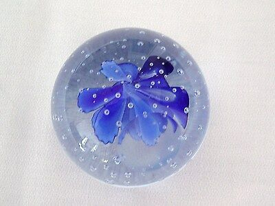 Glass Paperweight With Bright Blue Flower And Multi Bubbles Inclusions.