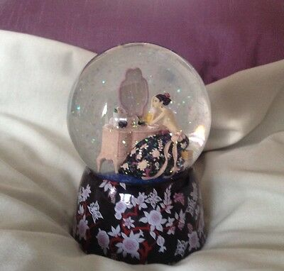 Past Times. Art Deco Lady Musical Snow Globe. The Backless Dress.