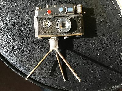 Vintage Camera Lighter On Tripod