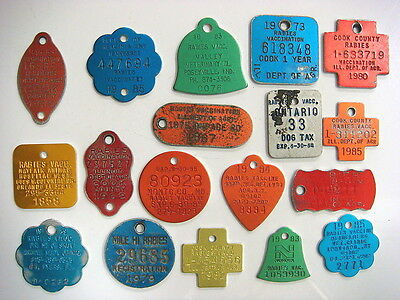 A COLORFUL lot of 18 different Rabies Tags