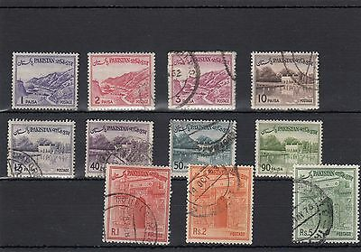 PAKISTAN.11 --EARLY USED STAMPS ON STOCKCARD.INCLUDES R1.Rs2.Rs5