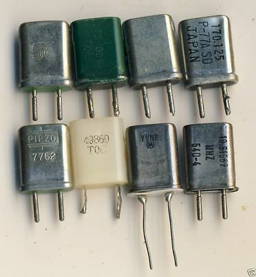 Eight Small Radio/ Scanner? Type Crystals