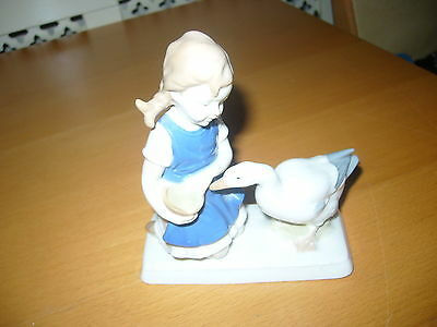 Lovely Porcelain Figurine Of A Girl Feeding A Goose Hand Painted Under Glaze