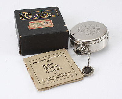 EXPO WATCH CAMERA, WITH CASSETTE, INSTRUCTIONS AND BOX (READ)/cks/192975