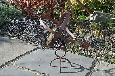 Antique style iron and brass armillary sphere garden ornament