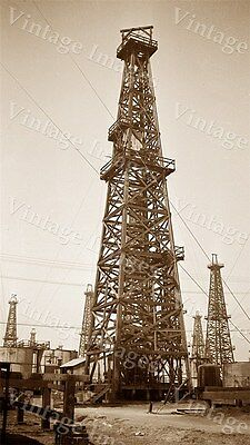 VINTAGE OIL WELL PHOTO DRILLING DERRICK RIG IN OILFIELD FIELD WITH WELLS &  TANKs