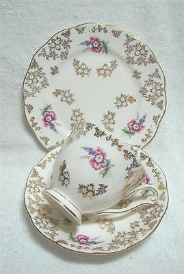 Vintage Queen Anne gold chintz Trio Flowers High Tea cup saucer plate