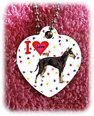 """Manchester Dog heart necklace 24"""" chain background of hearts"""
