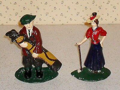 """Cast iron golf bookends man & woman, Hand painted, 8.25"""" tall, 5"""" base"""