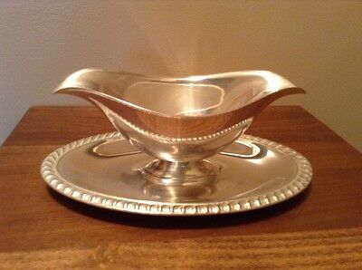 Vintage silverplate gravy sauce boat with attached plate