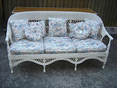 Antique Wicker Sofa with 3 Upholstered Cushions, with 7 matching pillows.8913a