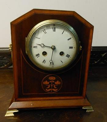 pretty french mahogany inlaid striking mantle clock
