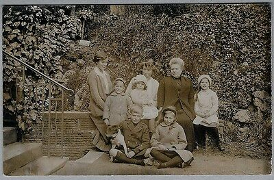 Edwardian/1920's era Postcard- Smart looking family group with their beloved dog